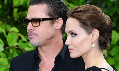 Анджелина Джоли и Брэд Питт на открытии выставки костюмов из фильма Малефисента в Лондоне